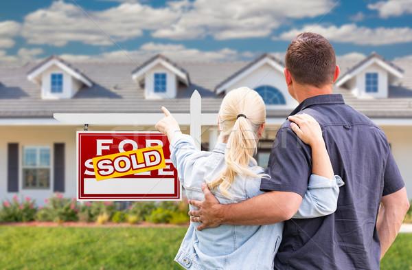 пару указывая проданный Сток-фото © feverpitch