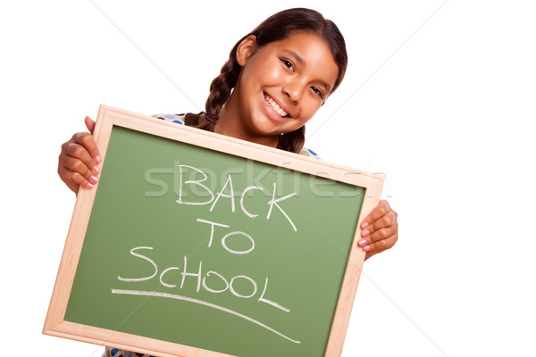 Stock photo: Pretty Hispanic Girl Holding Chalkboard with Back To School