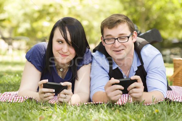 Fiatal pér park sms chat együtt vonzó okos Stock fotó © feverpitch