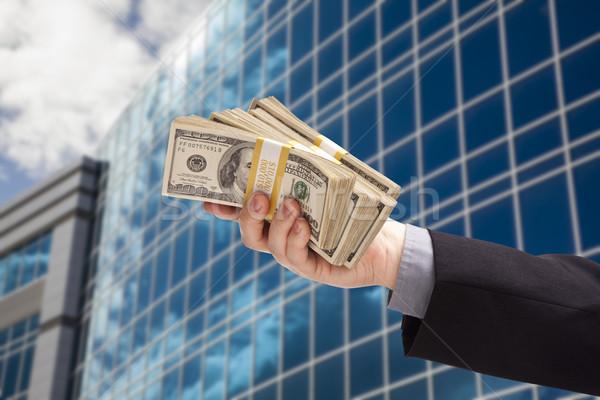 Férfi kéz tart boglya pénz vállalati Stock fotó © feverpitch