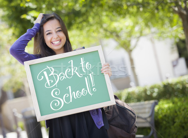 Mixed Race Female Student Holding Chalkboard With Back To School Stock photo © feverpitch