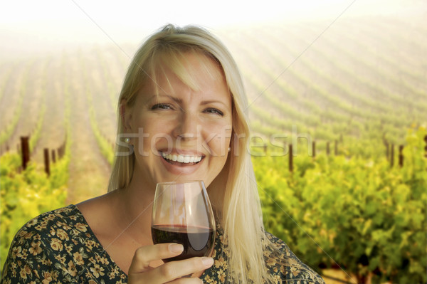 Stock photo: Attractive Woman Enjoying a Glass of Wine at the Vineyard
