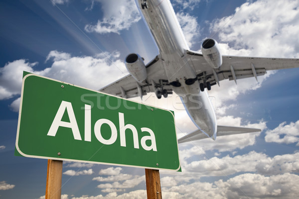Aloha zöld jelzőtábla repülőgép fölött drámai Stock fotó © feverpitch
