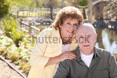Senior Couple on Bench in the Market Place Stock photo © feverpitch