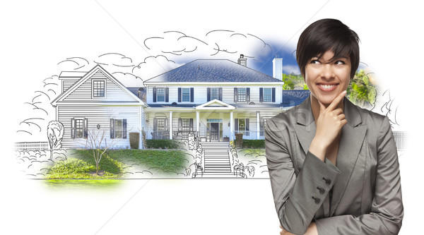 Mixed Race Female Gazing Over House Drawing and Photo Stock photo © feverpitch
