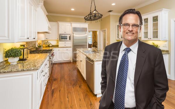 Man Wearing Necktie in Beautiful Custom Residential Kitchen Stock photo © feverpitch