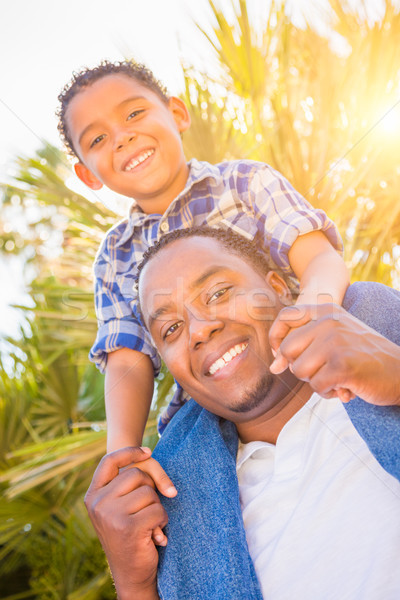 Mixed Race Son and African American Father Playing Piggyback Out Stock photo © feverpitch