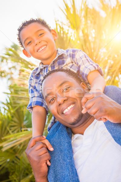 Félvér fiú afroamerikai apa játszik háton Stock fotó © feverpitch