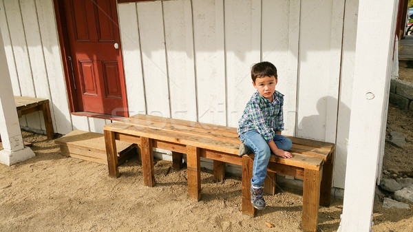 Cute Young Chinese and Caucasian Boy Sitting On Bench Outdoors Stock photo © feverpitch