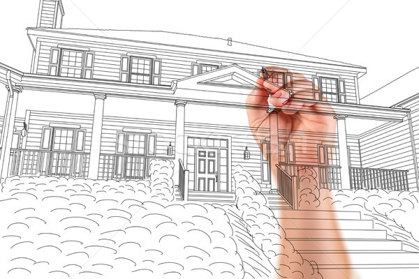 Male Hand Sketching with Pencil the Outline of a Beautiful House Stock photo © feverpitch