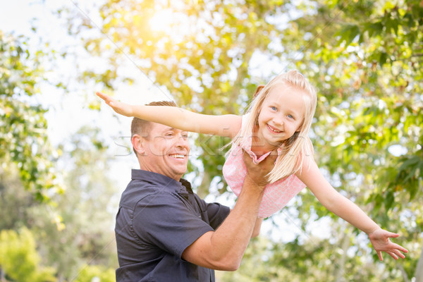 Young Caucasian Father and Daughter Having Fun At The Park Stock photo © feverpitch