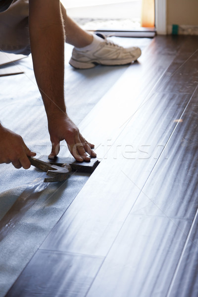 Stock photo: Man Installing New Laminate Wood Flooring