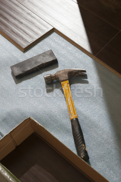 Stock photo: Hammer and Block with New Laminate Flooring