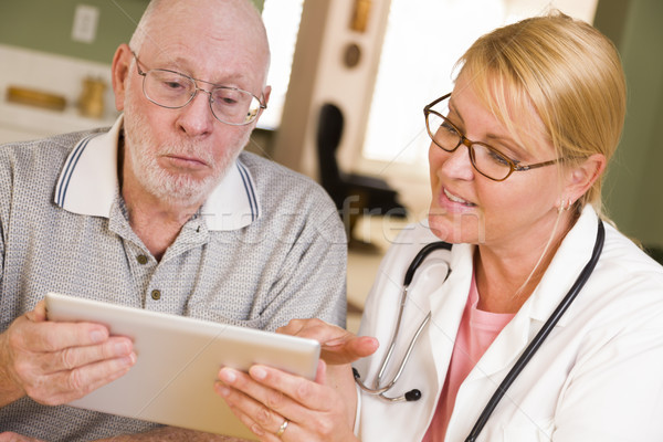 Doctor or Nurse Talking to Senior Man with Touch Pad Stock photo © feverpitch