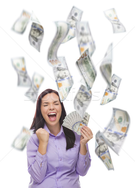 Stock photo: Happy Woman Holding the $100 Bills with Many Falling Around