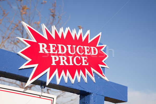 Red Reduced Price Burst Sign Stock photo © feverpitch