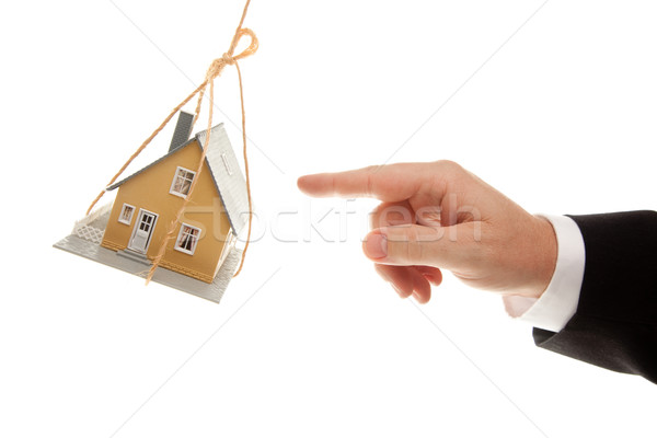 Swinging House and Business Man's Hand Reaching  Stock photo © feverpitch