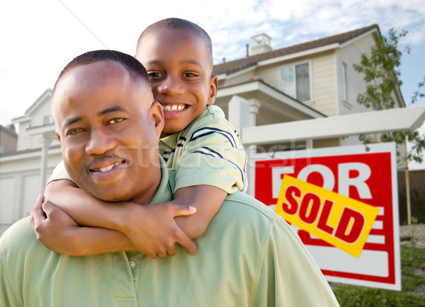 Father and Son In Front of Real Estate Sign and Home Stock photo © feverpitch