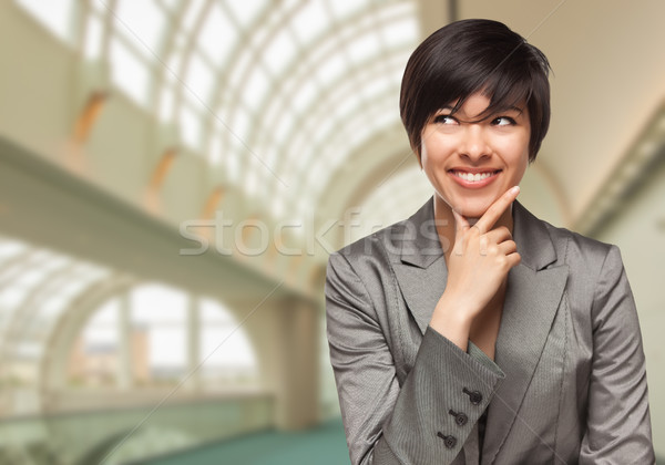 Businesswoman Inside Corporate Building Looking To The Side Stock photo © feverpitch