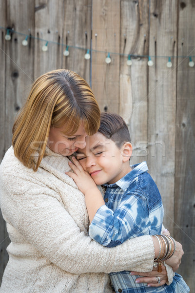 Mother and Mixed Race Son Hug Near Fence Stock photo © feverpitch