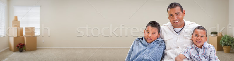 Young Hispanic Father and Sons Family Inside Room with Boxes Ban Stock photo © feverpitch