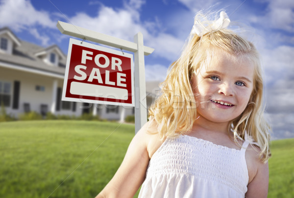 Cute Smiling Girl in Yard with For Sale Real Estate Sign and House Stock photo © feverpitch