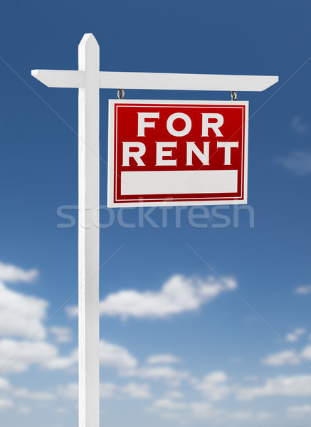 Right Facing For Rent Real Estate Sign on a Blue Sky with Clouds Stock photo © feverpitch