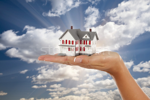 Model House in Female Hand on Sky Background Stock photo © feverpitch