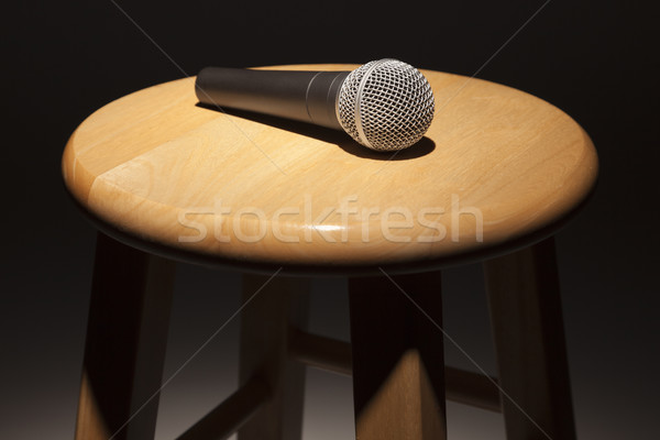 Microphone Laying on Wooden Stool Under Spotlight Stock photo © feverpitch