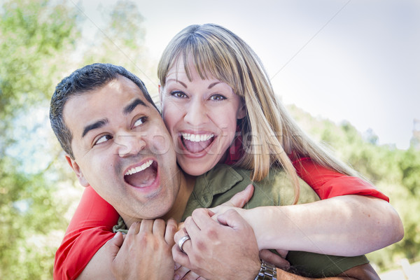Attractive Mixed Race Couple Piggyback at the Park Stock photo © feverpitch