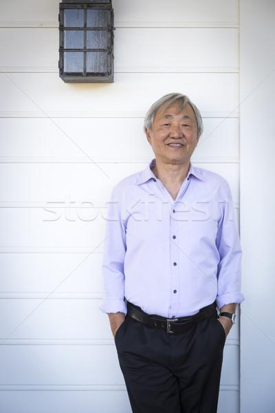 Vonzó idősebb kínai férfi portré boldog Stock fotó © feverpitch