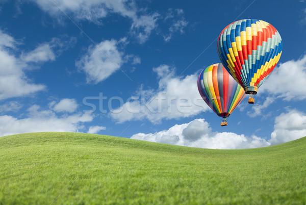 Hot Air Balloons In Beautiful Blue Sky Above Grass Field  Stock photo © feverpitch
