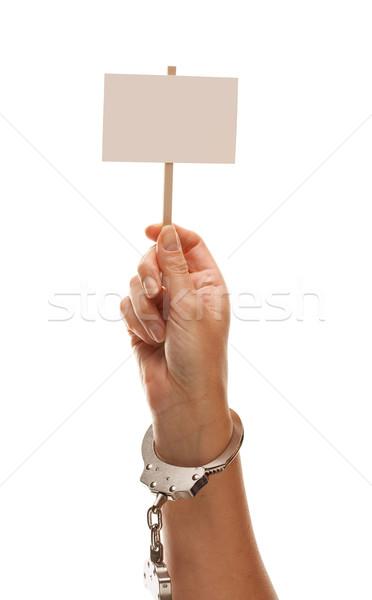 Megbilincselve nő tart fehér felirat izolált Stock fotó © feverpitch