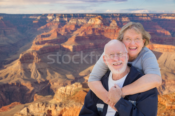 Happy Senior Couple Posing on Edge of The Grand Canyon Stock photo © feverpitch