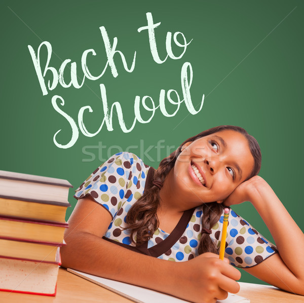 Cute Hispanic Girl Studying and Looking Up to Back To School Wri Stock photo © feverpitch