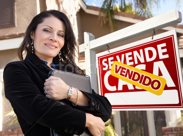Female Hispanic Real Estate Agent, Vendido Se Vende Casa Sign an Stock photo © feverpitch