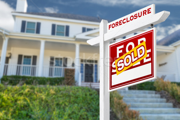 Right Facing Foreclosure Sold For Sale Real Estate Sign in Front Stock photo © feverpitch