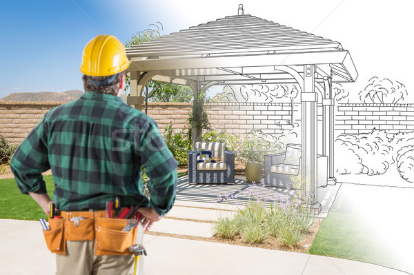 Contractor Standing Looking At Patio Pergola Design Drawing and  Stock photo © feverpitch