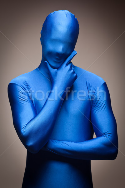 Man Wearing Full Blue Nylon Bodysuite Stock photo © feverpitch