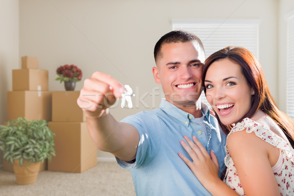 Young Military Couple with House Keys in Empty Room with Packed  Stock photo © feverpitch