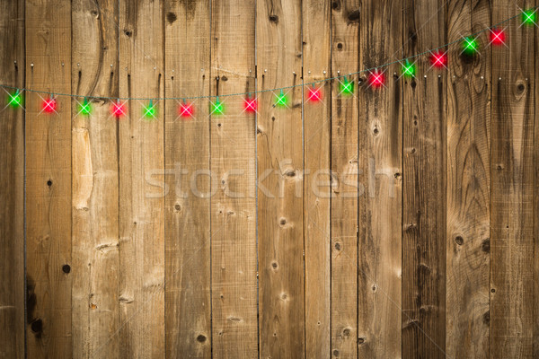Lustrous Wooden Background with Green and Red Christmas Lights Stock photo © feverpitch