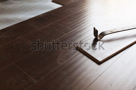 Pry Bar Tool with New Laminate Flooring Stock photo © feverpitch