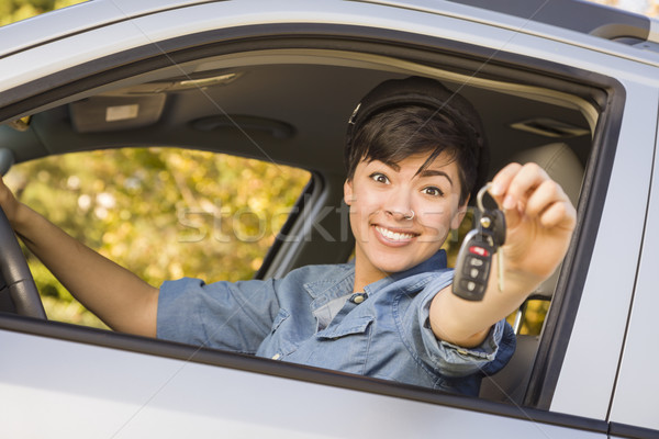 Happy Mixed Race Woman in Car Holding Keys Stock photo © feverpitch
