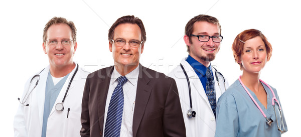 Smiling Businessman with Doctors and Nurses Stock photo © feverpitch
