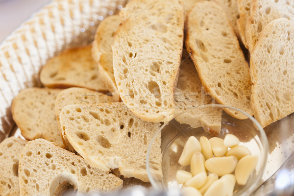 Tray of Fresh Made Sourdough Bread with Garlic Cloves Stock photo © feverpitch