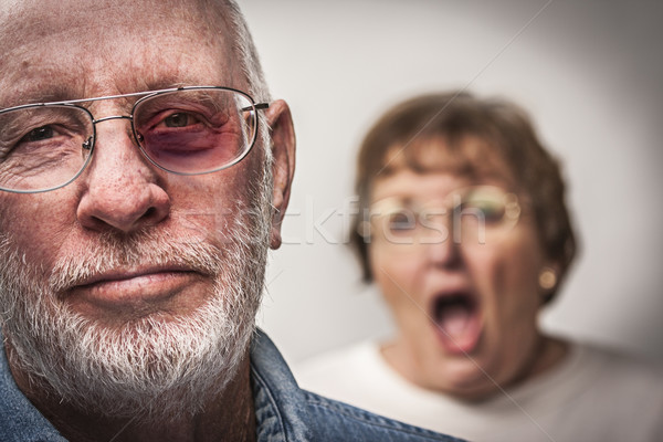 Battered and Scared Man with Screaming Woman Behind Stock photo © feverpitch