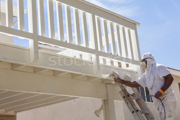 House Painter Spray Painting A Deck of A Home Stock photo © feverpitch