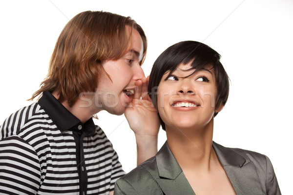 Attractive Diverse Couple Whispering Secrets Stock photo © feverpitch