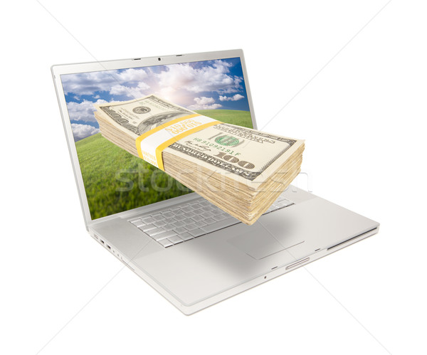 Laptop with Stack of Money Coming From Screen Stock photo © feverpitch