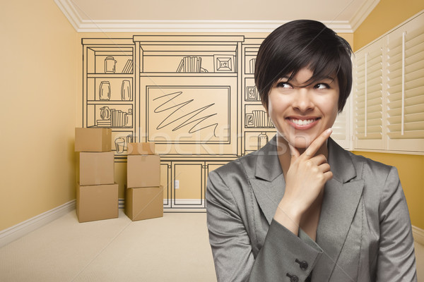 Mixed Race Female In Room With Drawing of Entertainment Unit Stock photo © feverpitch